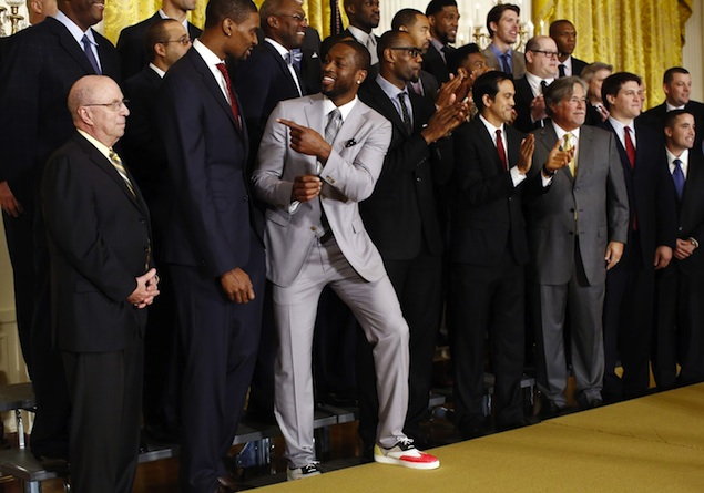 D. Wade wearing Christian Louboutin Golfito rose flat leather sneakers ($675) to the White House.